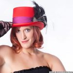 Beautiful red head model wearing a red hat with feathers and gloves, Dancer, Roodepoort Photographer